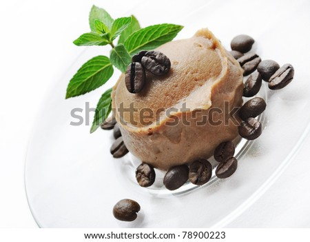 Ice cream decorated with fresh mint and coffee beans