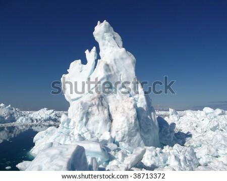Iceberg ocean landscape. Strange white shapes rising from the sea.