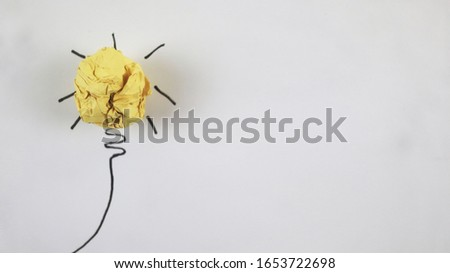 ideas / creative innovations of yellow paper light bulbs on a white background
