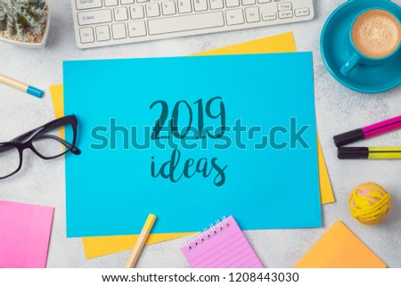2019 ideas text on colorful paper memo note with business office accessories. Top view from above #1208443030