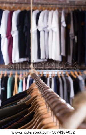 image of different colored garments in the modern shopping centre #1074184052