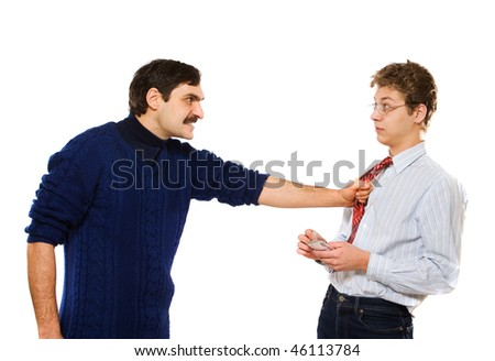 Image of workman holding by a businessman by his tie
