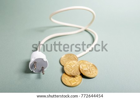 In the picture, symbols of electronic currency and ICO. Initial coin offering is the energy of money for start up.