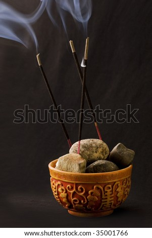 incense sticks on dark background