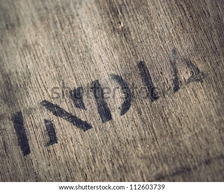 """India"" printed on very old dirty wooden box"