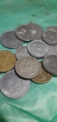 Indian coins one two and five rupees and gold colour coins