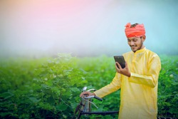Indian farmer with smartphone, Rural india