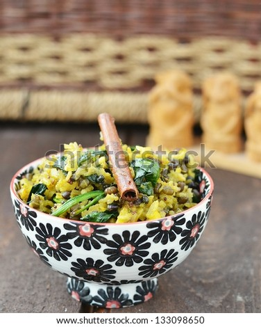 indian rice -khichdi in to the bowl