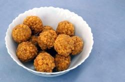 Indian street food Besan,Gram flour or garbanzo bean flour or chickpea flour, or pulse flour of ground chickpeas, laddu sweet