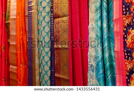 f0817ac11b Indian woman dress sarees or saris hung in display in a retail shop  #1433556431