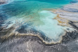 Industrial coal mine, abstract sendimentation tank of power plant , turquoise water like river delta