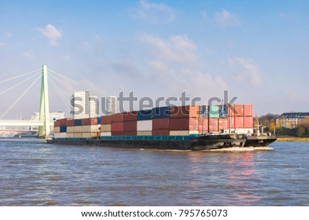 Inland shipping transport on the rhine river with containers, Large container vessel on the river rhein by Cologne