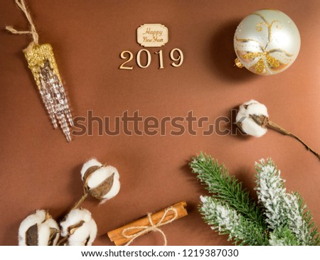 2019, inscription happy new year, fir branch, a branch of the cotton, faux icicle, Christmas decorations, Christmas decorations, Christmas ball, place the graphic on a brown background, #1219387030