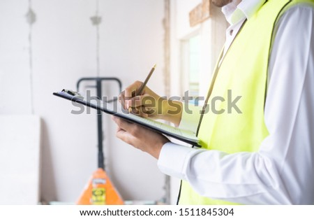 inspectors or engineers are checking the work of the contractor in constructon site