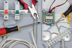Installation of electrical devices, wires in distribution board