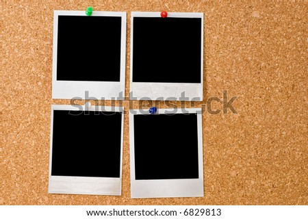 instant photos on a corkboard