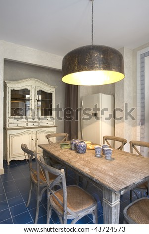 interior of a kitchen with big lamp, window and food on the table