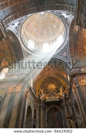 interior of church in, Lisbon, Portugal with light beam of god going down from the cupola