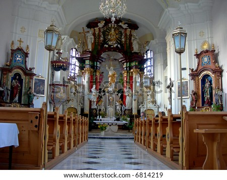 Interior of the church with altar and seats