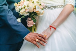 interracial marriage, hand in hand, a bouquet of the bride