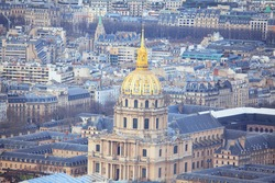 Invalides Cathedral with golden cupola in Paris . 7th arrondissement of Paris . Aerial view of France capital city downtown