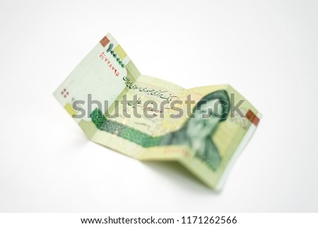 100,000 Iranian rial toman paper banknote. Money currency for a middle eastern country.  Imagine de stoc ©