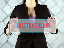 IRS TAX SCAM text in virtual screen.  IRS impersonation scams involve scammers targeting American taxpayers by pretending to be IRS collection officers
