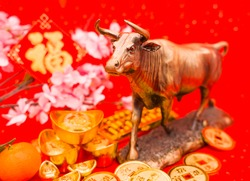 2021 is year of the ox,characters on leftside chinese wording mean:Chinese calendar for the year.Chinese characters on gold ingot translation: good bless for money.