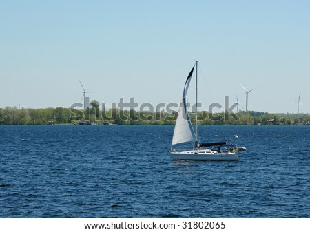 1000 Island scenery, Sailboat cruising along Wolfe Island