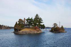 1000 islands region, World known Smallest Bridge between USA and Canada borders. Canada on the left and USA on the right. Thousand Islands, USA