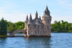 1000 Islands, Thousand Islands - June 19, 2016: Boldt Castle on Heart Island. Power house, New York State. Unfiltered, natural lighting. Tourist routs. St. Lawrence River, USA-Canada border.