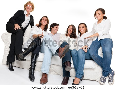 Isolated happy family sitting on a sofa watching TV