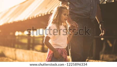 It's time to walk through the farm and enjoy. Granddaughter and grandfather on the farm together.  Copy space.  Copy space.  #1225896334