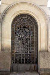 Italian architecture. Old, monumental doors with bars for many years.