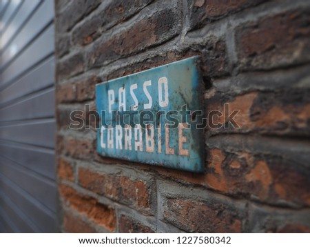 Italian sign indicating a driveway. Passo carrabile means driveway.