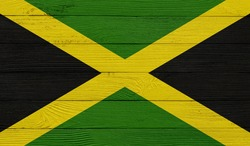 Jamaica flag on a wooden texture. Wood texture, planks Wooden texture background flag. Flag painted with paints on wood