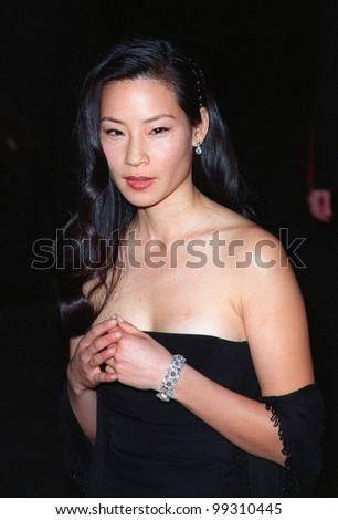 "28JAN99:  Actress LUCY LIU at the world premiere, in Los Angeles, of her new movie ""Payback"" in which she stars with Mel Gibson, Deborah Kara Unger & Maria Bello.  Paul Smith / Featureflash"