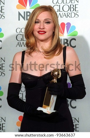 "19JAN97:  Actress/singer MADONNA at the Golden Globe Awards where she won Best Actress in a Musical or Comedy for ""Evita."" Please Credit: Pix: JEAN CUMMINGS"