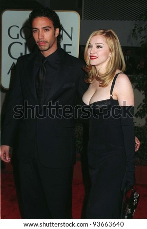 "19JAN97:  Actress/singer MADONNA with boyfriend CARLOS LEON at the Golden Globe Awards where she won Best Actress in a Musical or Comedy for ""Evita.""        Please Credit: Pix: JEAN CUMMINGS - stock photo"