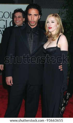 "19JAN97:  Actress/singer MADONNA with boyfriend CARLOS LEON at the Golden Globe Awards where she won Best Actress in a Musical or Comedy for ""Evita.""        Please Credit: Pix: JEAN CUMMINGS"