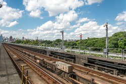 2020, january; Sao Paulo, Brazil; Urban train rail with buildings at the backside. Metro line, near the Portuguesa Tiete Station.