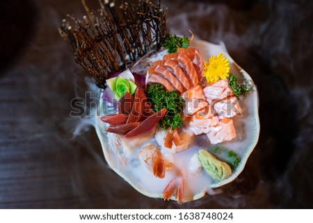 ,Japanese food,Sashimi set,Japanese gourmet sashimi,Raw fish Sashimi slice traditional Japanese food set includes Raw Salmon, Raw Tuna, Raw Yellow Tail (Hamachi),Raw flounder(Hirame),Raw shrimp.