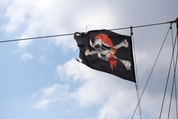 jolly roger flag against the sky