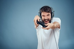joyful man with headphones on his head with a joystick