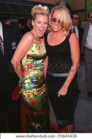 "28JUL98:  Actress/presenter JENNY McCARTHY (left) & sister JOANNA at the premiere of ""BASEketball"" at Universal Studios.  Jenny stars in the movie with Yasmine Bleeth, Trey Parker & Matt Stone."