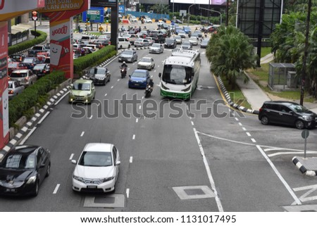 10 july 2018 afternoon cityscape of a busy street flanked by office towers and signs at a dynamic view from a fast moving car at Jalan Bukit Bintang at Kuala Lumpur Malaysia #1131017495
