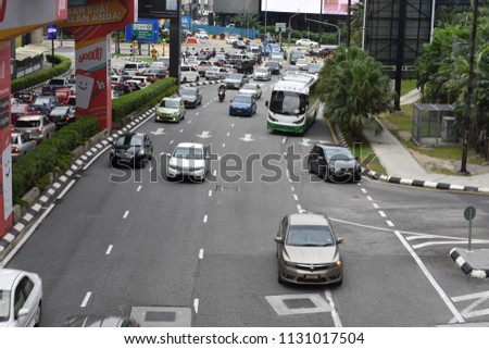 10 july 2018 afternoon cityscape of a busy street flanked by office towers and signs at a dynamic view from a fast moving car at Jalan Bukit Bintang at Kuala Lumpur Malaysia #1131017504