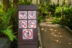 26 july 2020,ChaingMai, Thailand. Warning sign on display of Do not open umbrella,  Do not pick flowers, Do not ride a bicycle, No smoking and Do not litter in Royal park , ChaingMai, Thailand.