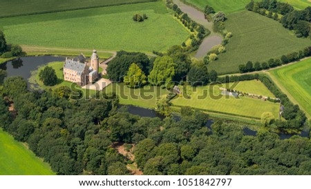 31 July 2017, Dalfsen, Holland. Aerial view of historic medieval castle Rechteren. A large estate with a beautiful garden surrounded by a moat in the province of Overijssel. Stock photo ©