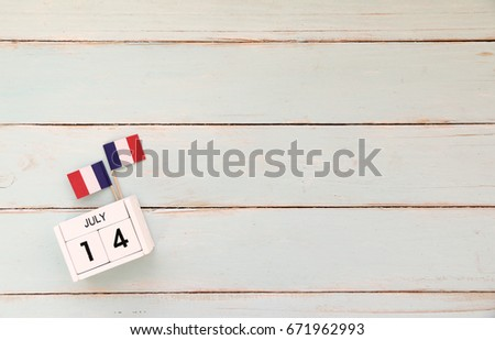 14 july Wooden calendar Happy Bastille Day. Concept National Day France,Copy space,minimal style and vintage style